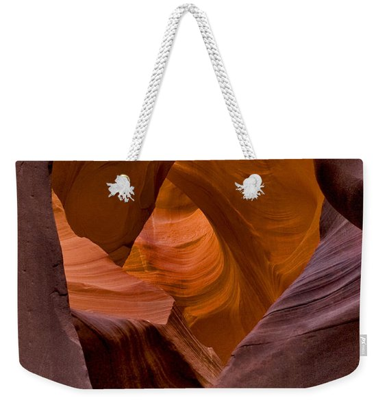 Weekender Tote Bag featuring the photograph Three Faces In Sandstone by Mae Wertz