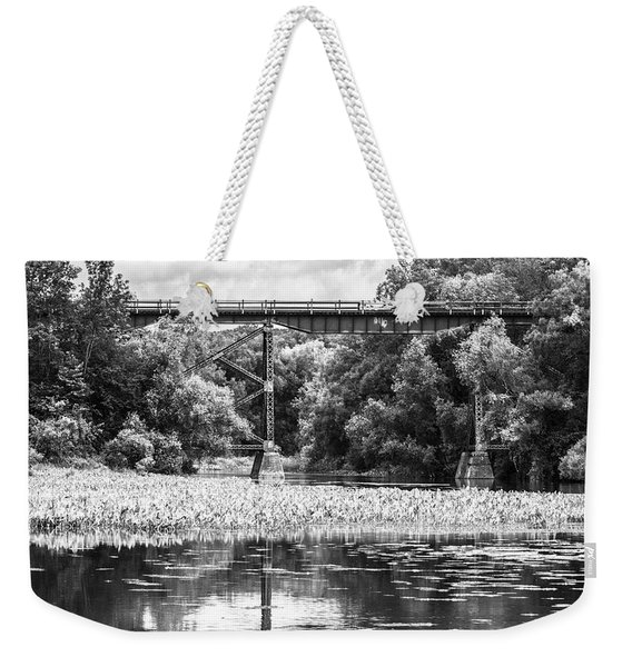 Weekender Tote Bag featuring the photograph Train Bridge by Garvin Hunter