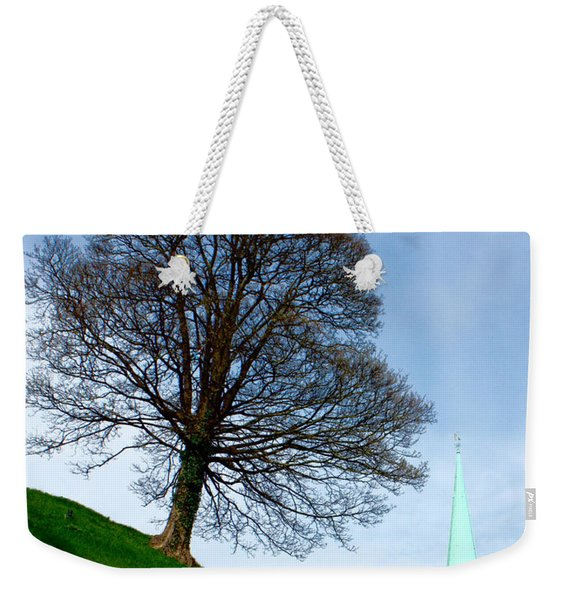 Weekender Tote Bag featuring the photograph Tree On A Hill by Jeremy Hayden