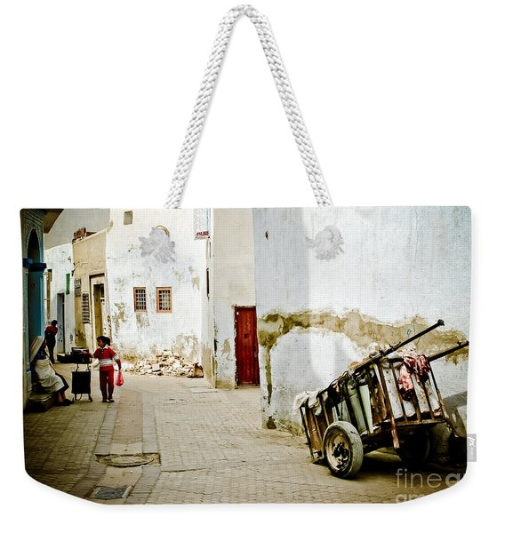 Weekender Tote Bag featuring the photograph Tunisian Girl by John Wadleigh
