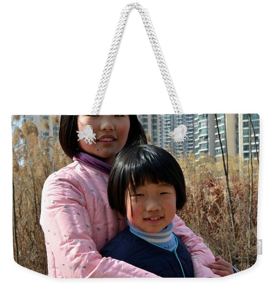 Two Chinese Teen Sisters Hug  And Embrace Shanghai China Weekender Tote Bag