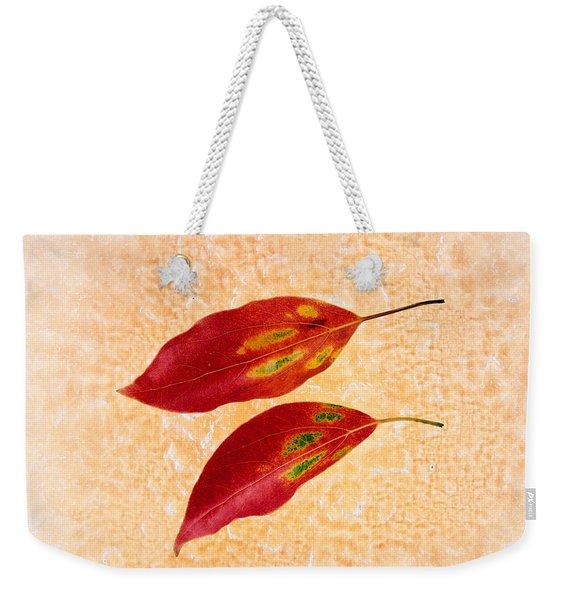 Two Red Leaves On Pink Background Weekender Tote Bag