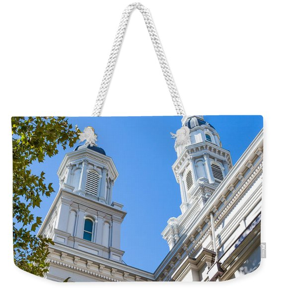 Weekender Tote Bag featuring the photograph Two Spires by Susan Leonard
