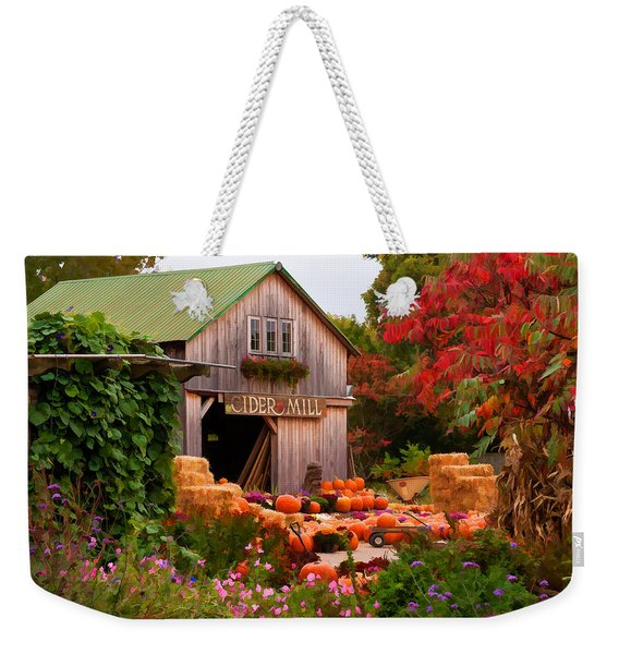 Weekender Tote Bag featuring the photograph Vermont Pumpkins And Autumn Flowers by Jeff Folger