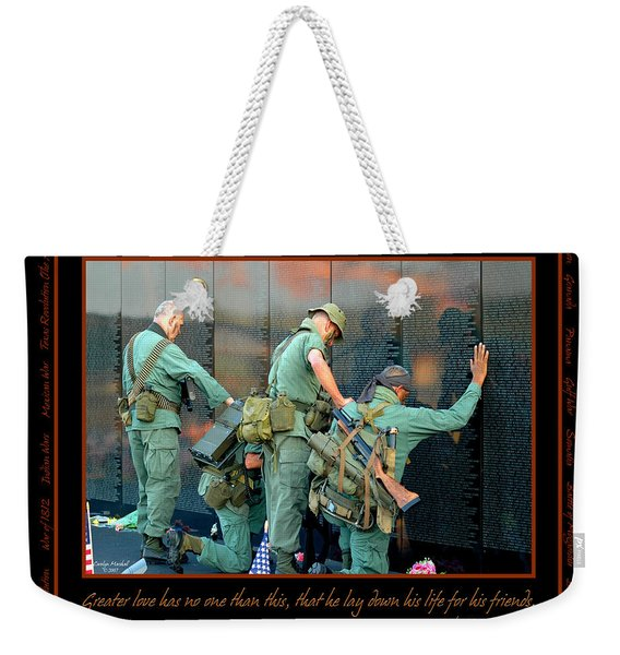 Weekender Tote Bag featuring the photograph Veterans At Vietnam Wall by Carolyn Marshall