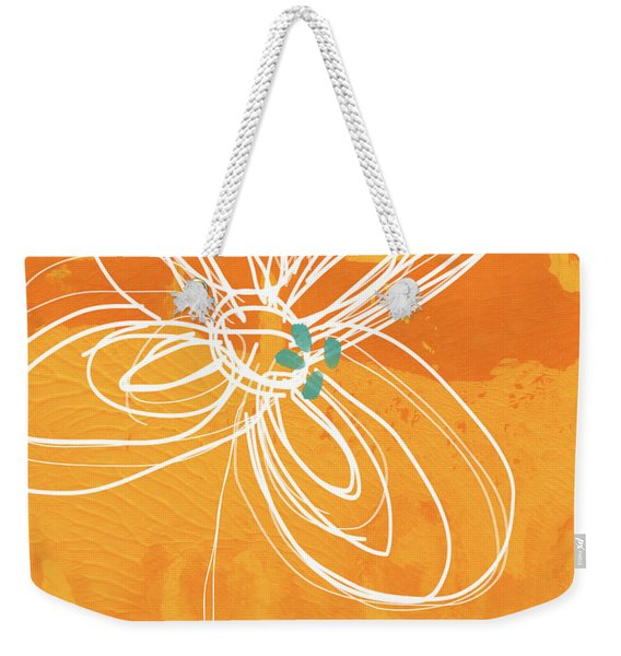 White Flower On Orange Weekender Tote Bag
