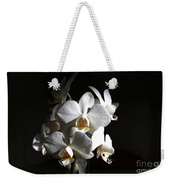 Weekender Tote Bag featuring the photograph White Orchids by Jeremy Hayden