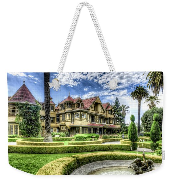 Weekender Tote Bag featuring the photograph Winchester Mystery House by Jim Thompson