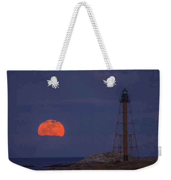 Weekender Tote Bag featuring the photograph Winter Moon Rising Over Marblehead Light by Jeff Folger