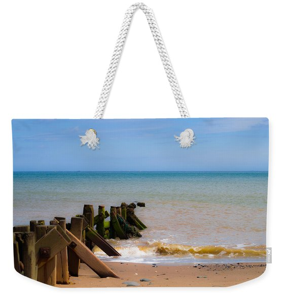 Weekender Tote Bag featuring the photograph Withernsea Groynes by Scott Lyons