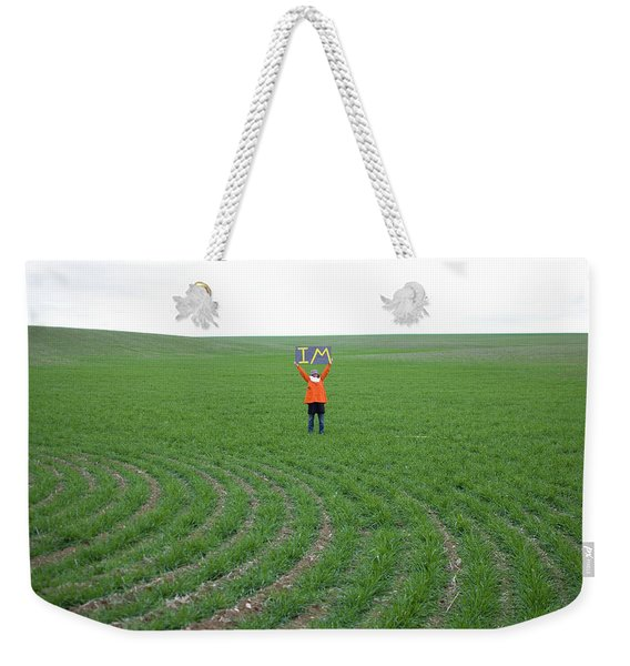 Woman In Big Field Holds Up Sign Weekender Tote Bag