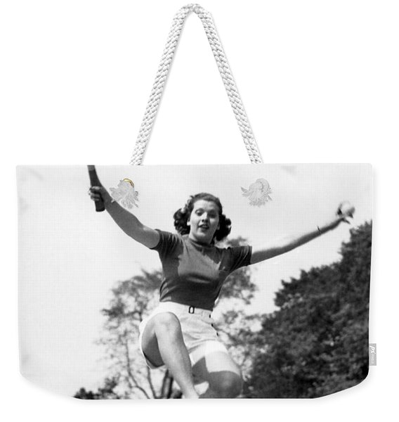 Woman Player Leaping Over Net Weekender Tote Bag