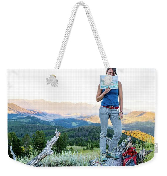 Woman Shows Off Her Mountain Drawing Weekender Tote Bag