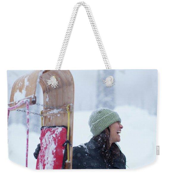 Woman Standing With Toboggan Sled Weekender Tote Bag