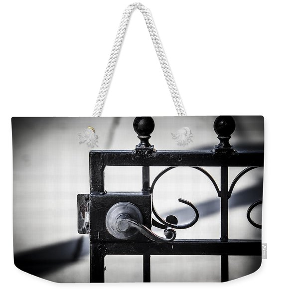 Weekender Tote Bag featuring the photograph Ybor City Gate by Carolyn Marshall