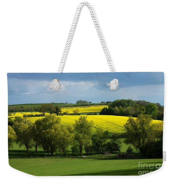 Weekender Tote Bag featuring the photograph Yellow Fields In The Sun by Jeremy Hayden
