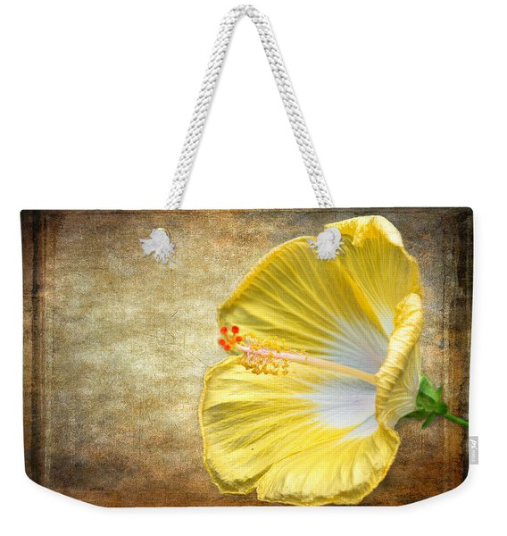 Weekender Tote Bag featuring the photograph Yellow Hibiscus by Garvin Hunter