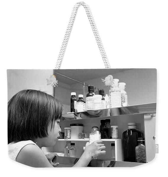 Young Girl In Medicine Cabinet Weekender Tote Bag