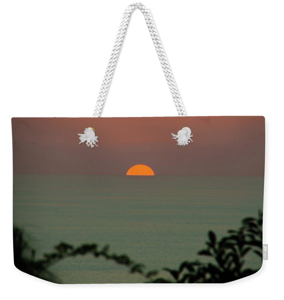 Weekender Tote Bag featuring the photograph Sunset Over The Sea by Michael Goyberg