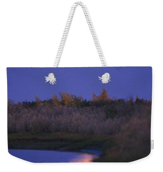 A Full Moon Is Reflected Weekender Tote Bag