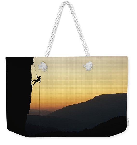 A Man Rappels Down A Cliff Weekender Tote Bag