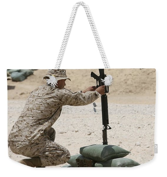 A Marine Hangs Dog Tags On The Rifle Weekender Tote Bag