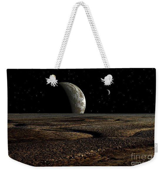 A Planet And Its Moon Are Dimly Lit Weekender Tote Bag