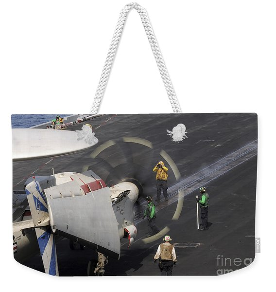 A Sailor Directs An E-2c Hawkeye Weekender Tote Bag