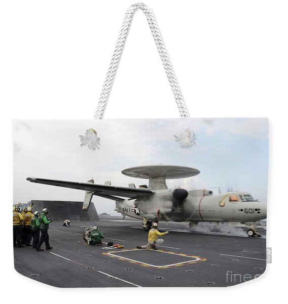 A Shooter Signals The Launch Of An E-2c Weekender Tote Bag