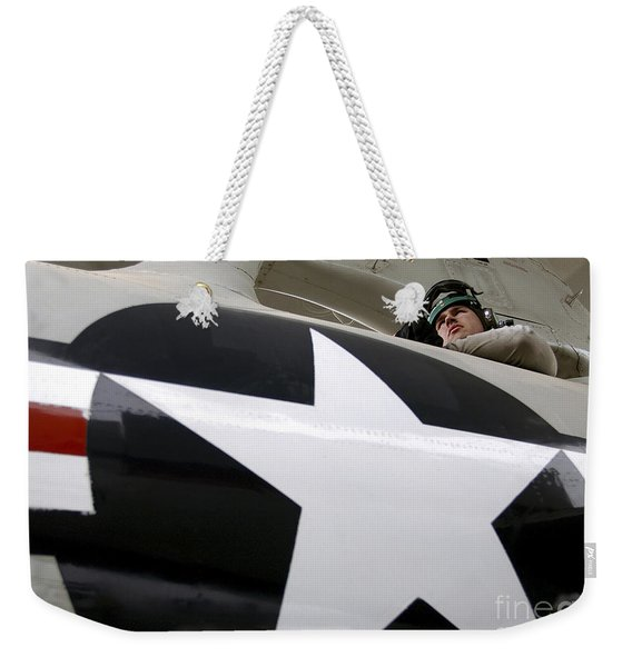 Airman Looks Out A Hatch On The Topside Weekender Tote Bag