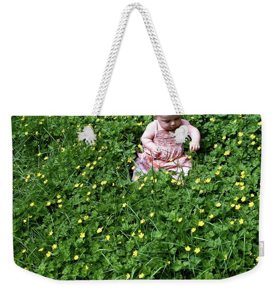 Weekender Tote Bag featuring the photograph Baby In A Field Of Flowers by Lorraine Devon Wilke