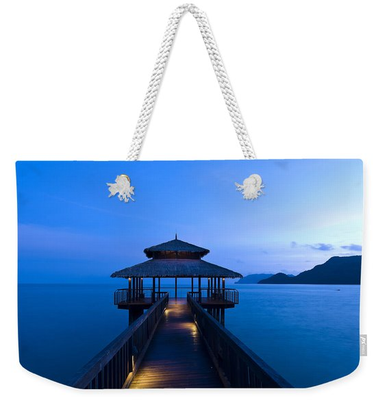 Building At The End Of A Jetty During Twilight Weekender Tote Bag