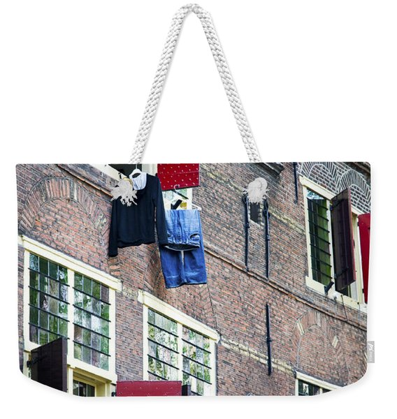 Clothes Hanging From A Window In Kattengat Weekender Tote Bag