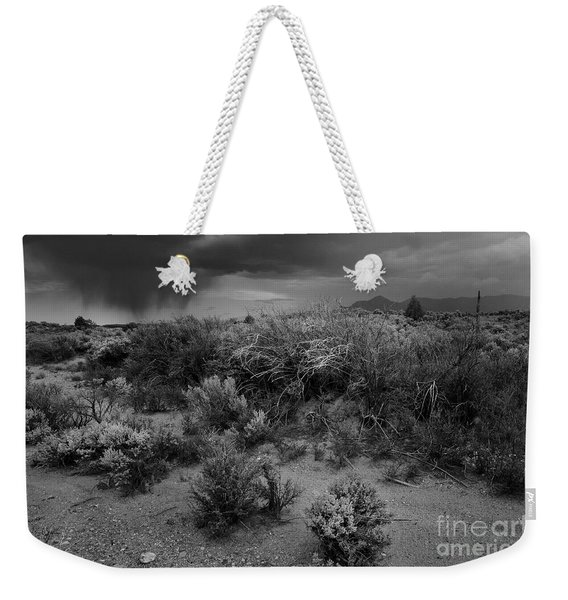 Weekender Tote Bag featuring the photograph Distant Shower by Ron Cline