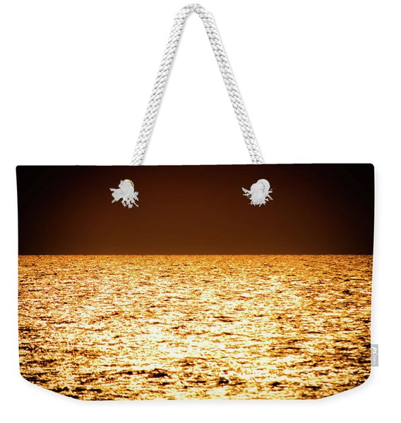 Weekender Tote Bag featuring the photograph Fiery Sunset Over The Sea by Michael Goyberg