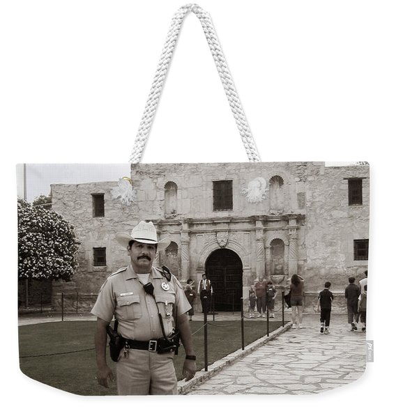 Weekender Tote Bag featuring the photograph He Guards The Alamo by Lorraine Devon Wilke