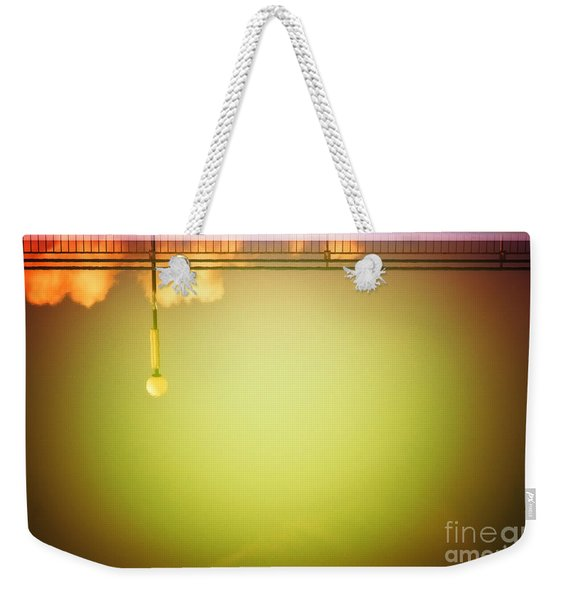 Lamp And Clouds In A Swimming Pool Weekender Tote Bag