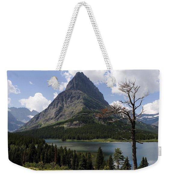 Weekender Tote Bag featuring the photograph Lone Tree At Sinopah Mountain by Lorraine Devon Wilke