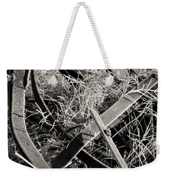 Weekender Tote Bag featuring the photograph No More Plowing by Ron Cline