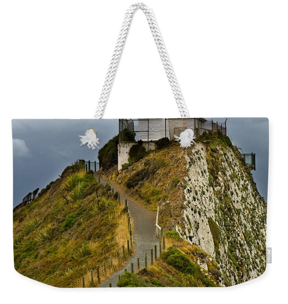 Nugget Point Light House And Dark Clouds In The Sky Weekender Tote Bag