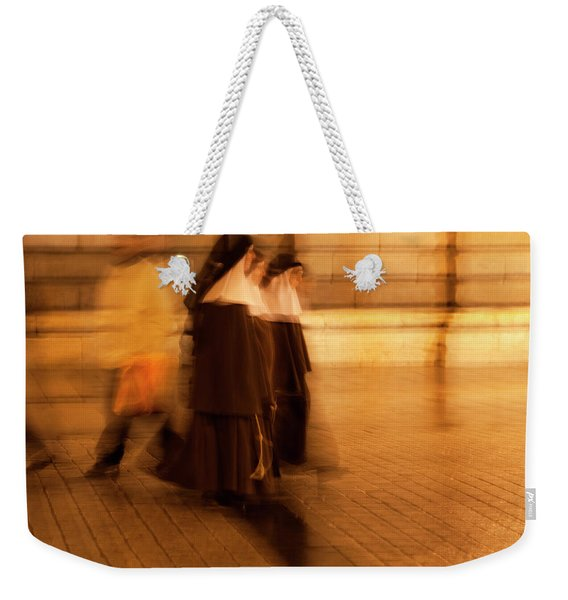 Weekender Tote Bag featuring the photograph Piety In Motion by Lorraine Devon Wilke