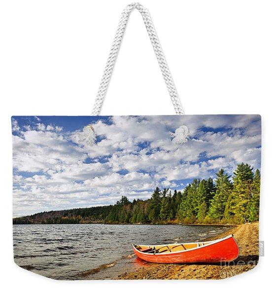 Red Canoe On Lake Shore Weekender Tote Bag