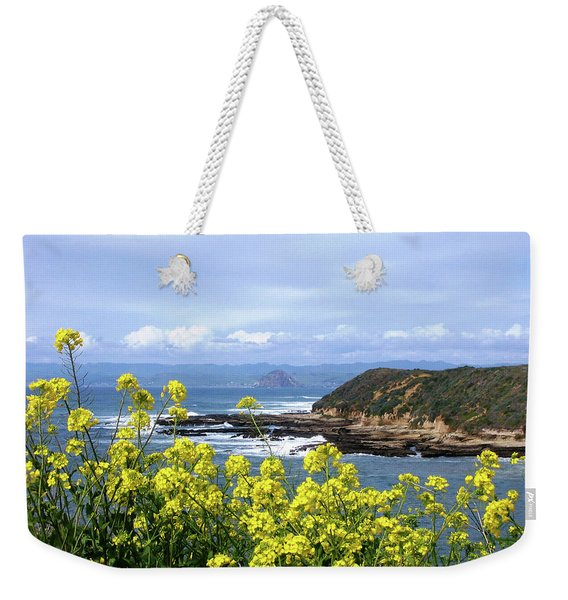 Weekender Tote Bag featuring the photograph Through Yellow Flowers by Lorraine Devon Wilke