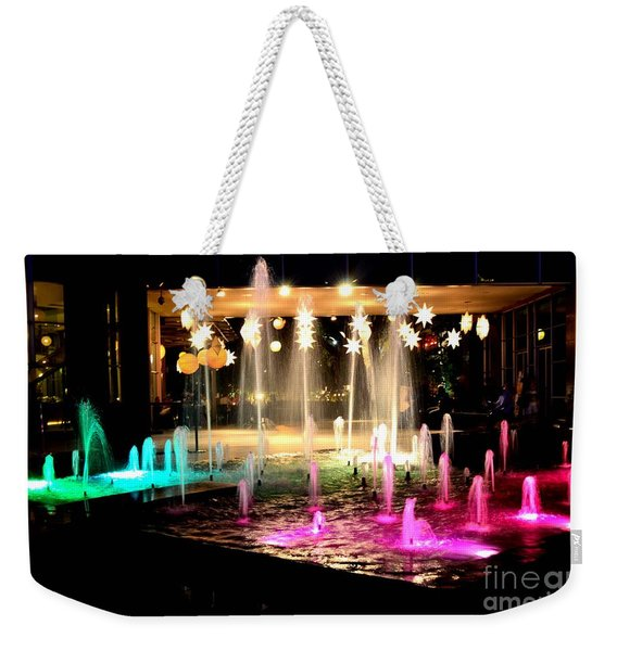 Water Fountain With Stars And Blue Green With Pink Lights Weekender Tote Bag