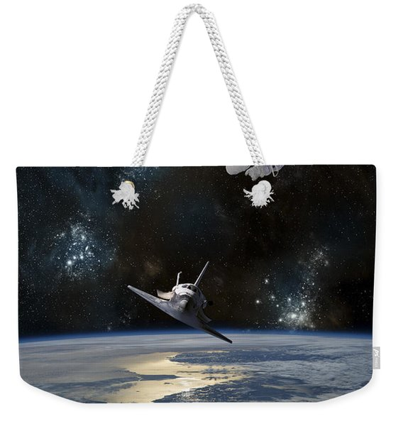 An Astronaut Drifting In Space Weekender Tote Bag
