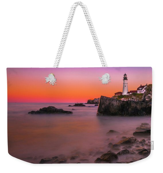 Weekender Tote Bag featuring the photograph Maine Portland Headlight Lighthouse At Sunset by Ranjay Mitra