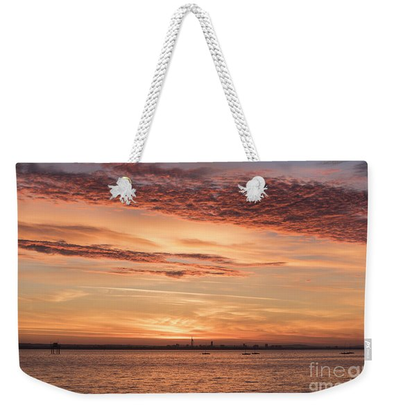 Weekender Tote Bag featuring the photograph Golden Sunrise Over Portsmouth  by Clayton Bastiani