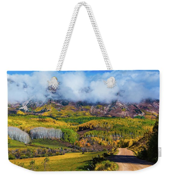 Weekender Tote Bag featuring the photograph The Road To The Elk Mountains by John De Bord