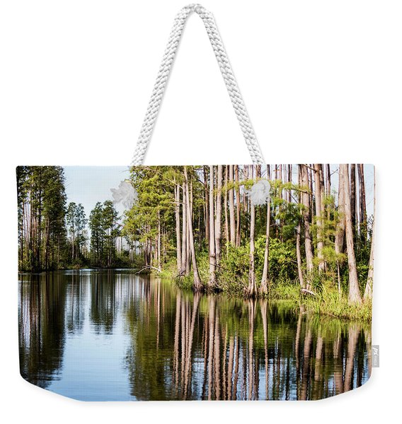 Weekender Tote Bag featuring the photograph Yin Yang by Sally Sperry