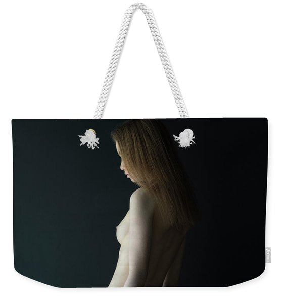 Girl In Front Of Black Wall Weekender Tote Bag